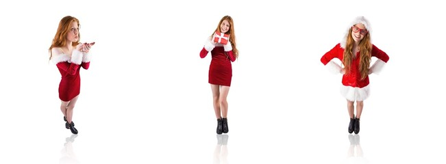 Composite image of festive redhead blowing over hands