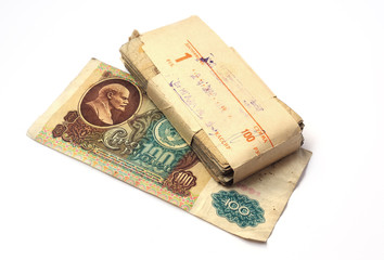 pack of Soviet rubles lies on top of the bill denomination of on