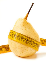 Pear and measuring tape isolated