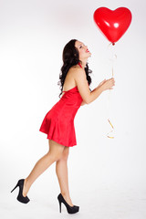 Sexy brunette with red ballon