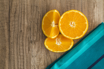 Oranges with blue napkin