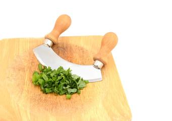 Chopped fresh basil leaves with a rocking knife