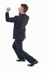 Businessman in suit pushing with his fists