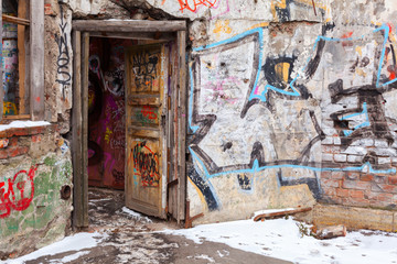 Old courtyard walls painted with colorful graffiti