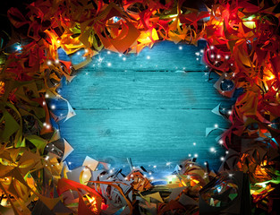 blue wooden background in a frame of lights with copy space