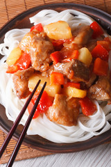 Pork with vegetables and rice noodles  vertical top view
