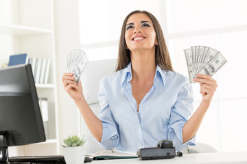Happy Businesswoman Holding Money