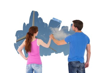 Composite image of couple painting together