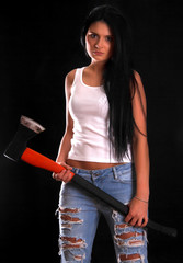 Young woman with a big axe