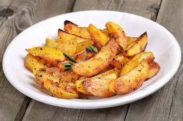 Potato wedges on white plate