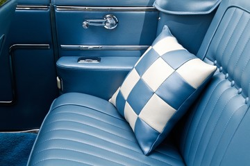 The backseat of a classic car