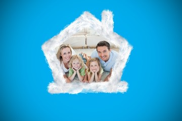 Composite image of happy family on the floor