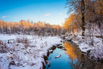 Stream in a snow covered meadow, in rural York County, Pennsylva