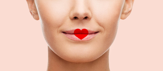 close up of woman face with heart shape on lips