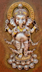 The Indian God Ganesha made from clay in low relief carving