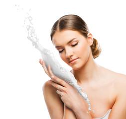 Beautiful woman with skin cream splash