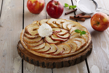 Open apple pie puff pastry with ice cream
