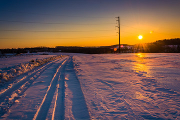 Sunset over a snow-covered dirt road in rural York County, Penns