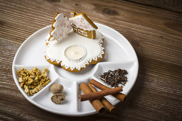 Cookies in a plate on wooden background