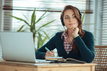 Girl with headphones and laptop