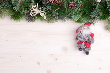 light board with pine needles and cones Christmas toys and Chris