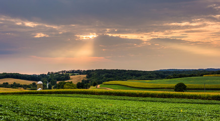Sunset over farm fields and rolling hills in rural York County,