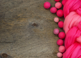 pink wool for felting and place for text