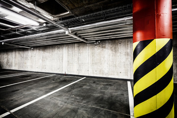 Concrete wall underground parking garage interior