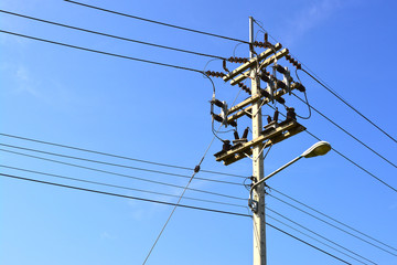 Electricity post on the blue sky.