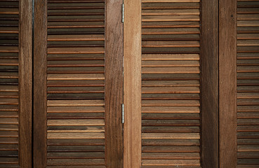 The wood louver door pattern for background classic style