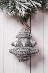 Textile Christmas decoration with fir branches on wood backgroun
