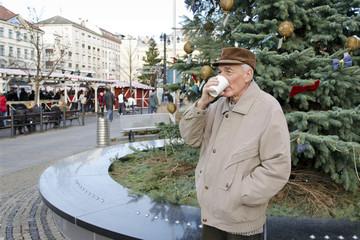 Senior man on the christmas market