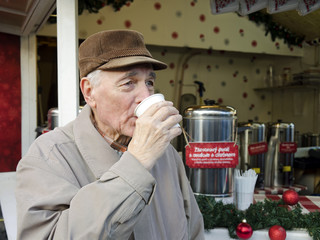 Senior man on the christmas market