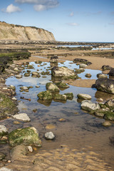 Pools and cliff at low tide at Robin Hoods Bay, Yorkshire