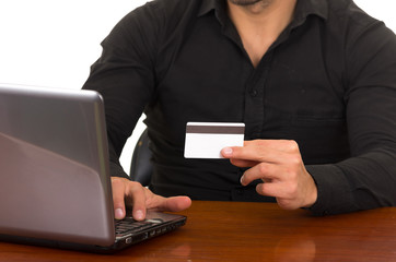 young man buying online with credit card