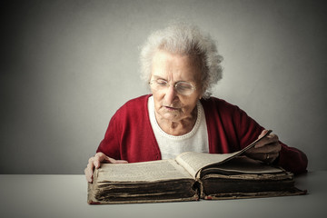 Wise woman reading a book