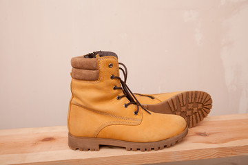 Yellow Winter shoes on wooden background