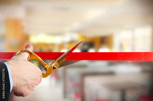 Grand opening, cutting red ribbon - 75102742