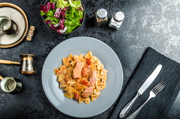Farfalle with tomato sauce and roasted salmon