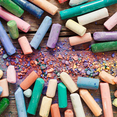 Collection of rainbow colored artistic pastel crayons with pigme