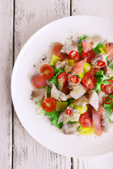 Fresh fish salad with vegetables
