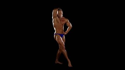 Bodybuilder muscular on black background