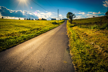 The sun setting over a country road near Cross Roads, Pennsylvan