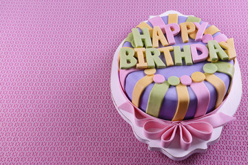 Delicious birthday cake on table close-up