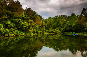 Trees and storm clouds reflecting in a pond in York County, Penn