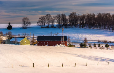 View of a barn and snow-covered hills in rural York County, Penn