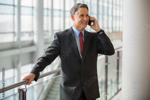 Elder business man calling by phone at the airport - 75108335