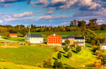 View of barn and houses on a farm in rural York County, Pennsylv