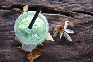 smoothies milk green tea latte in nature background