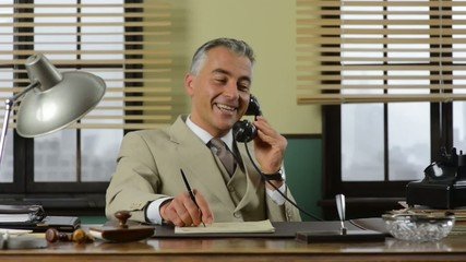 Confident vintage businessman working at desk